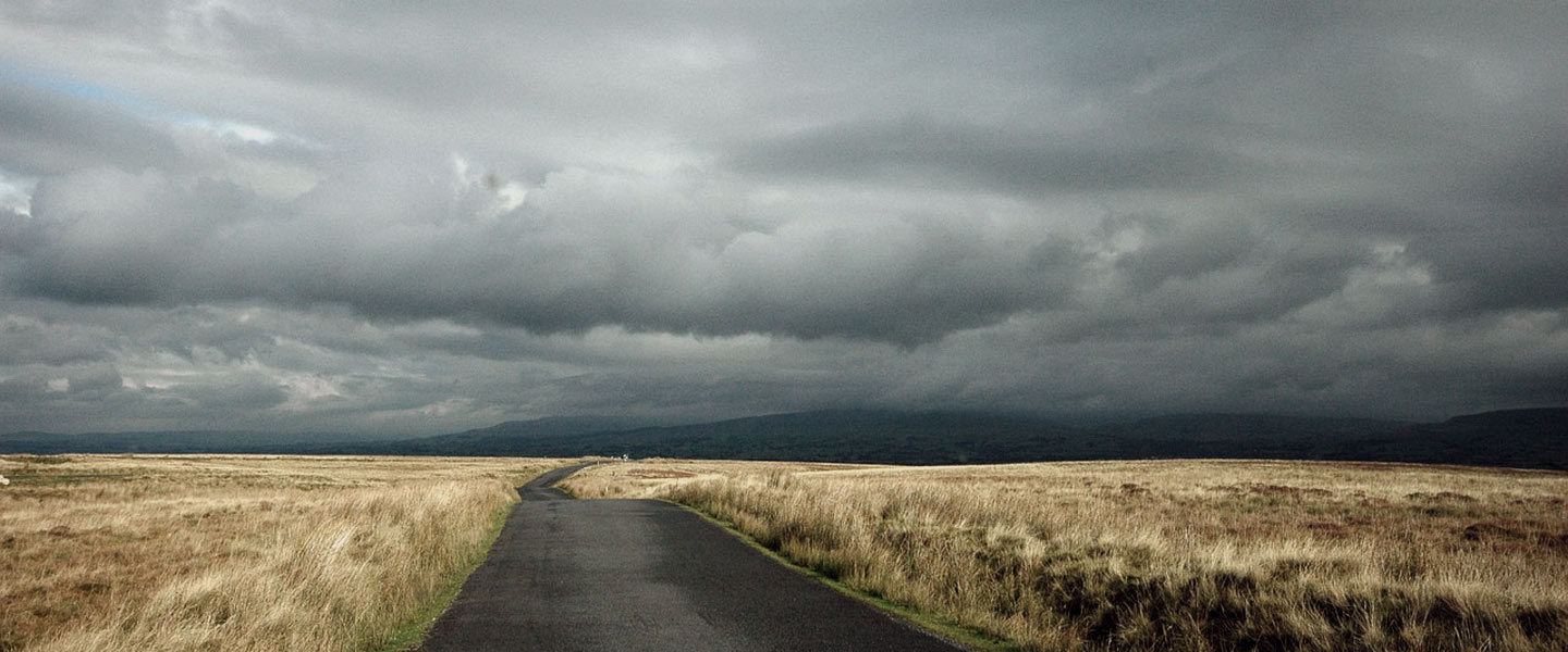 image of long road into storm
